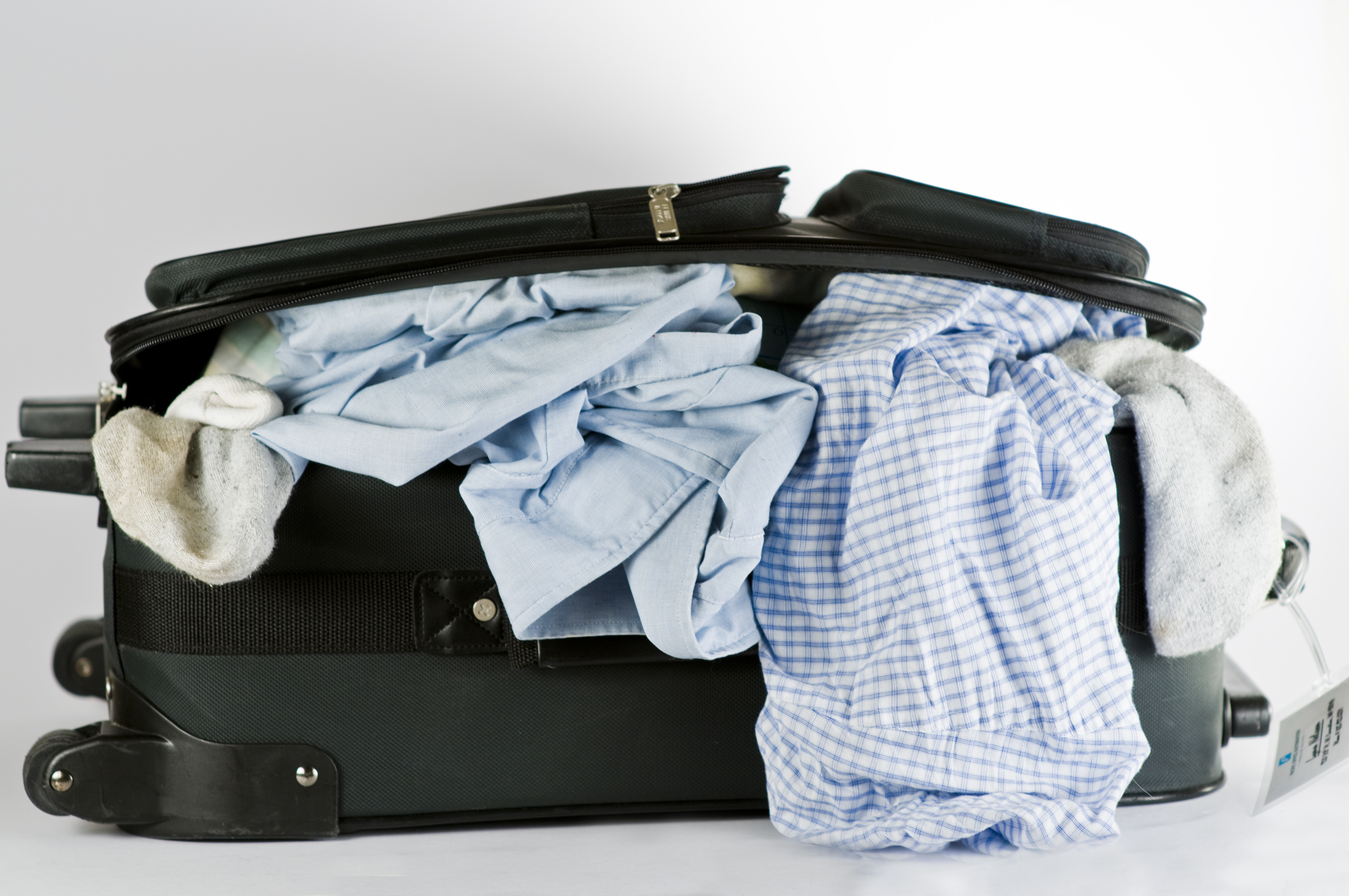 stuffed suitcase3a 6 Ways to Save Money While Traveling
