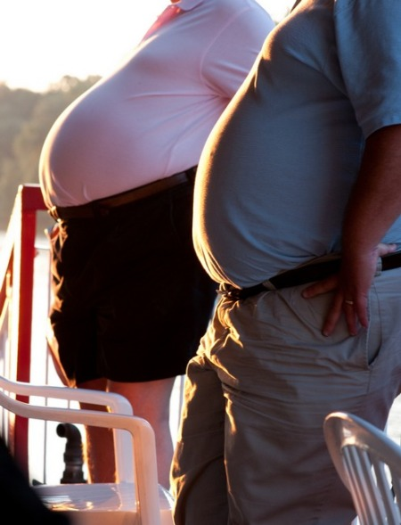 Two Tummies on a River Cruise.  (Notice how they lean backwards against the railing.)